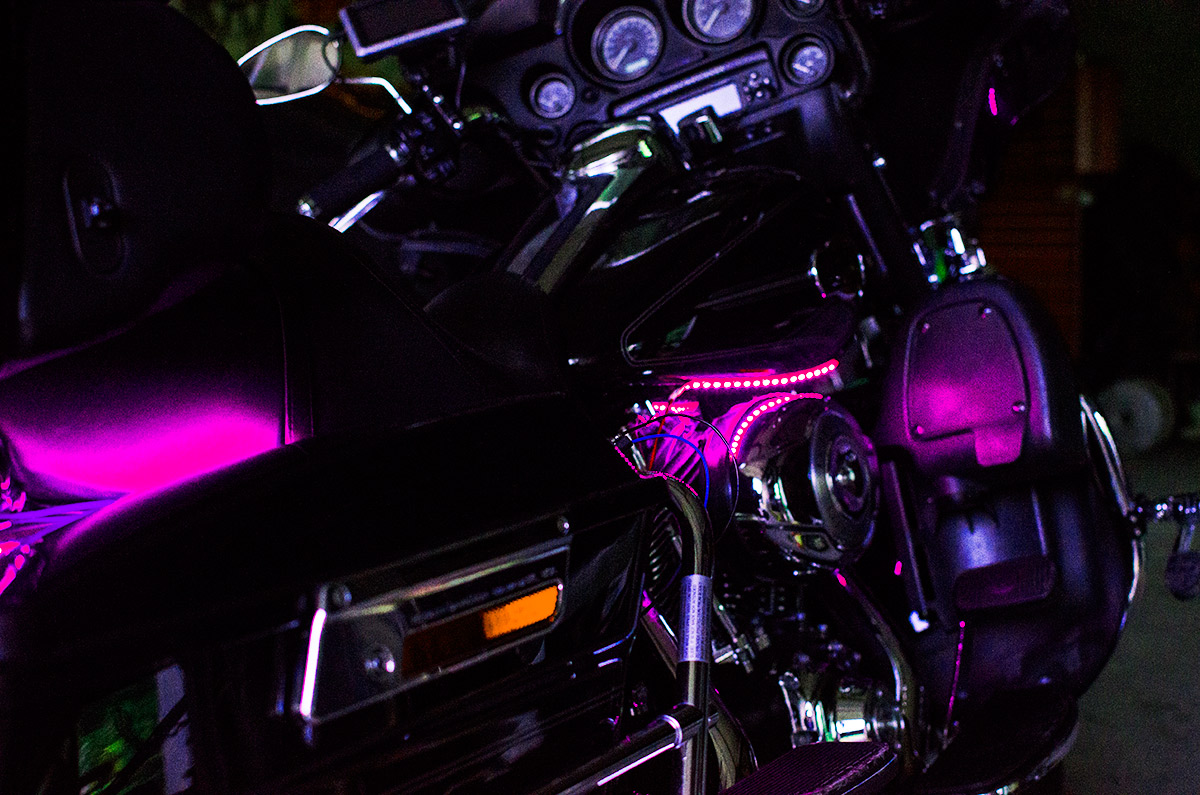pink motorcycle led light kit on a harley davidson